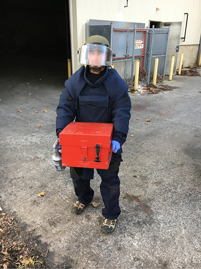man carrying a secured box